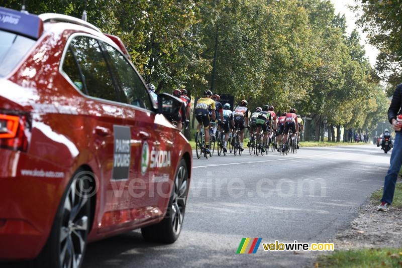 The breakaway followed closely by the official car